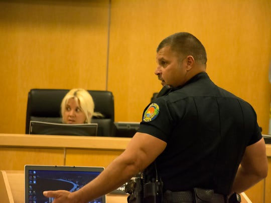 File: MIPD Officer Kevin Hennings testifies before Special Magistrate Myrnabelle Roche.
