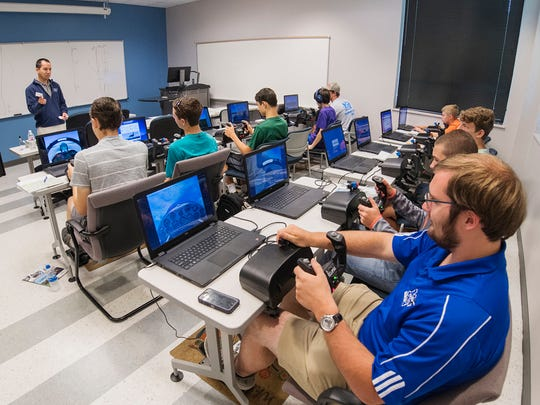 High school and middle school students attending the 2018 Introduction to Aviation and Professional Pilot Advanced Camp get training Thursday, June 14, in the Flight Simulator Lab at the Murfreesboro Airport.