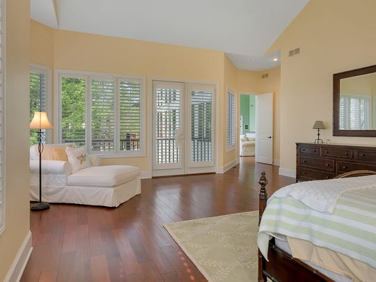 The master bedroom features a spacious walk-in closet, a large built-in desk and access to a private balcony.
