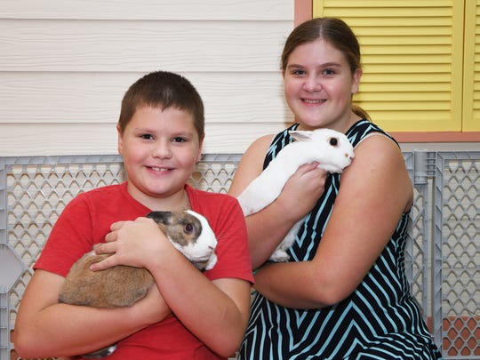 Simon and Shannon Meuter with Snowball and Autumn at the seventh annual Southeast Bunfest at the Kane Center in Stuart.