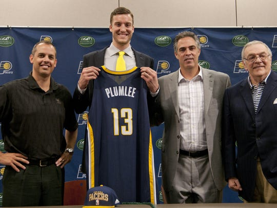 Pacers draft choice Miles Plumlee, center, is all smiles along with coach Frank Vogel, left, General Manager Kevin Pritchard and team president Donnie Walsh at a press conference at Bankers Life Fieldhouse.
