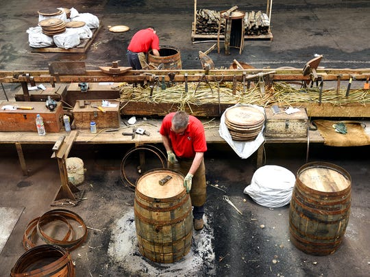 Workers at Scotland's Speyside Cooperage fashion oak