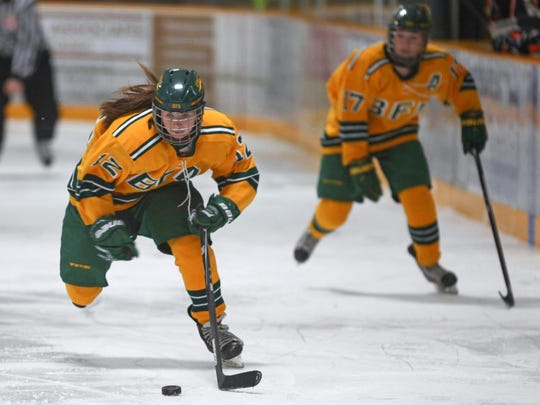 BFA's Lizzie Hill rushes the puck up the ice during a high school girls hockey game earlier this season.