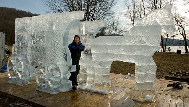 Ice sculptor and festival co-founder Robert Patalano with the Horsedrawn Ice Wagon, one of the centerpieces at the 2012 festival.