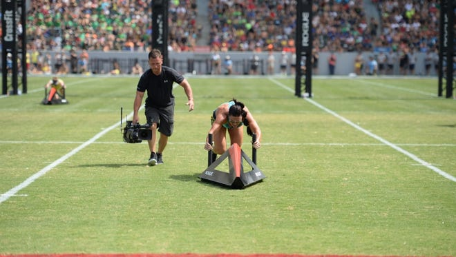 Cape Coral's Lauren Brooks pushes a sprint sled during the fourth of 13 events at the CrossFit Games in Carson, Calif.
