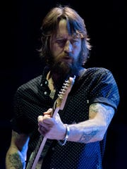 Foo Fighters guitarist Chris Shiflett performs during a show in South Dakota in November 2017. SAM CARAVANA/ARGUS LEADER