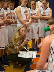Dickson County coach Catie Embrey with her team.