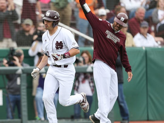 Mississippi State's Reid Humphreys (12) from Brandon, MS (Northwest Rankin HS) is congratulated by assistant coach Nick Mingione after hitting a home run. Mississippi State and Texas A&M played a college baseball game on Saturday, April 16, 2016 at Dudy Noble Field in Starkville. (Photo by Keith Warren) Mississippi State and Texas A&M played a college baseball game on Saturday, April 16, 2016 at Dudy Noble Field in Starkville. (Photo by Keith Warren)