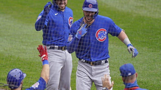 Chicago Cubs' Kris Bryant is congratulated by teammates after hitting a solo home run during the second inning of a baseball game against the Chicago White Sox in Chicago on Sunday.