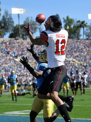 Utah wide receiver Tim Patrick, right, makes a catch in the end zone as UCLA defensive back John Johnson defends during the first half of an NCAA college football game, Saturday, Oct. 22, 2016, in Pasadena, Calif.