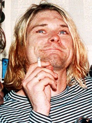 Lead singer Nirvana Kurt Cobain is shown in a 1993 file photo. Cobain is the focus of a new documentary that probes the life and untimely death of the Nirvana singer-guitarist. It will be released in theaters next year and air exclusively on HBO, the network said Tuesday/