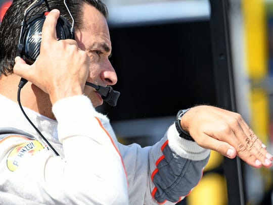 Helio Castroneves debriefs after testing for Team Penske