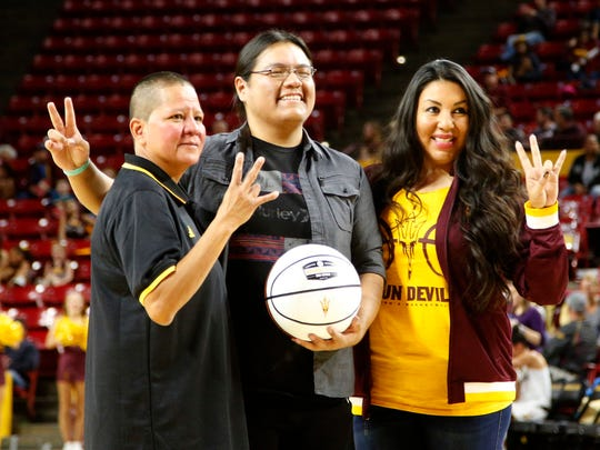 Ryneldi Becenti (left)  Annabell Bowen, ASU director of American Indian Initiaitves (right) present the inaugural Ryneldi Becenti award to Warren Castiano at Wells Fargo Arena in Tempe on Dec. 17, 2016.