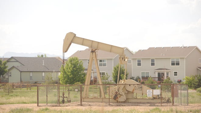 An oil well operates near homes in this file photo.