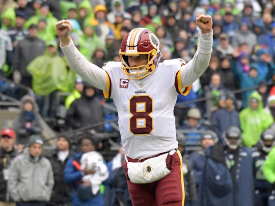 Washington Redskins quarterback Kirk Cousins (8) celebrates after a touchdown in the second quarter against the Seattle Seahawks during an NFL football game at CenturyLink Field.