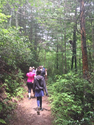 The Hayford family and extended family walk a trail in northern Georgia.