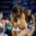 The Memphis Grizzlies Grizz Girls dancers perform during a timeout in the second half of an NBA basketball game against the Portland Trail Blazers Saturday, March 21, 2015, in Memphis, Tenn. The Grizzlies won 97-86.