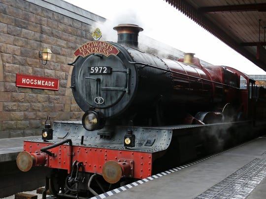 The Hogwarts Express arrives at Hogsmeade station during a preview of Diagon Alley at the Wizarding World of Harry Potter at Universal Orlando, Thursday, June 19, 2014, in Orlando, Fla.