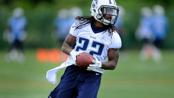 Titans running back Dexter McCluster (22) hustles back to the huddle during practice at Saint Thomas Sports Park on May 1.