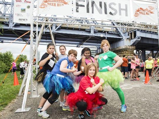 Runners and walkers sampled specialty craft beers during the 2.5-mile Cincinnati Beer Run / Walk.