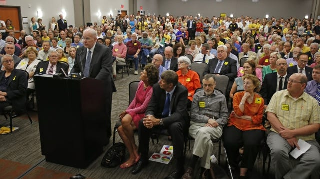 Businessman Otto M. Budig Jr. speaks before a standing-room-only crowd during a public meeting of the Hamilton County commissioners  about the proposed $331 million renovation of Music Hall and Union Terminal, hosted at the Sharonville Convention Center.