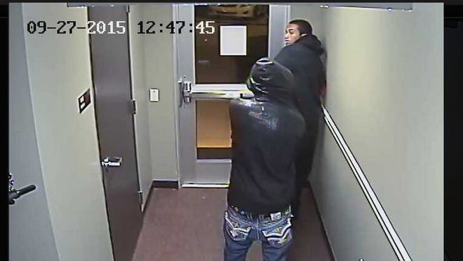 Police seek these two suspects in connection with the robbery of an East Lansing apartment.