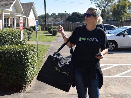 Regina McGinty, a driver with Waitr, delivers a meal