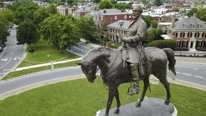 FILE This Tuesday June 27, 2017 file photo shows the statue of Confederate General Robert E. Lee that stands in the middle of a traffic circle on Monument Avenue in Richmond, Va. Proposed rules for political rallies at Richmond's Robert E. Lee statue call for limiting crowd size and banning guns.