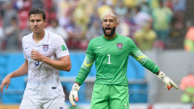 United States goalkeeper Tim Howard (1) directs his teammates during the first half of the match against Germany during the 2014 World Cup at Arena Pernambuco.