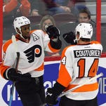 Philadelphia Flyers' Wayne Simmonds (17) celebrates his goal against the Ottawa Senators with teammate Sean Couturier (14) during the second period of an NHL hockey game in Ottawa, Ontario, Tuesday, Dec. 1, 2015. (Fred Chartrand/The Canadian Press via AP) MANDATORY CREDIT