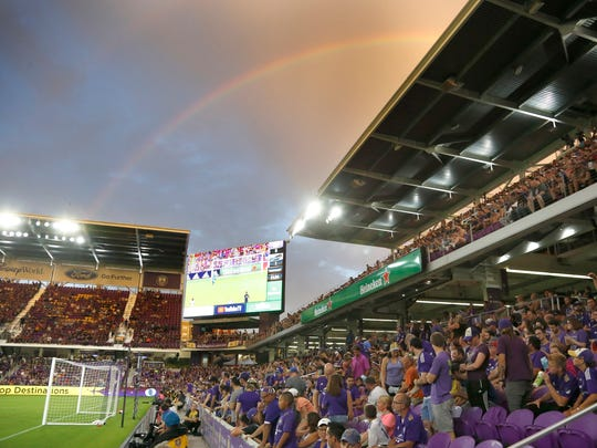 A rainbow is seen over the field during the first half