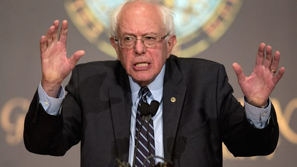 Bernie Sanders re-enacts the T. rex-chasing-the-Ford-Explorer