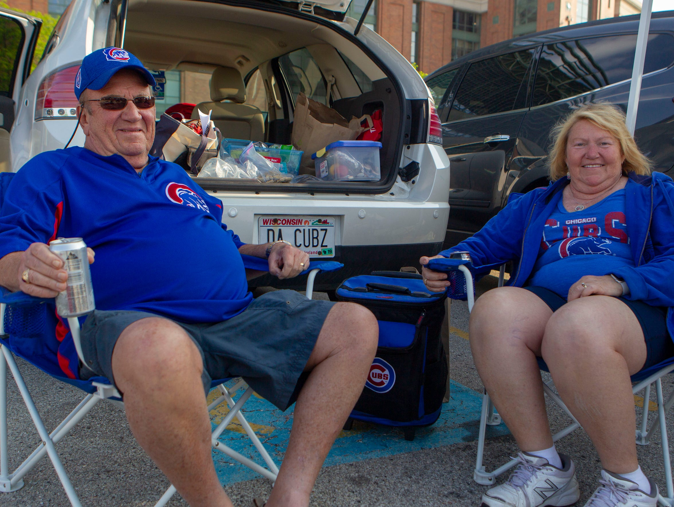 Dick and Lu Schmidt of Appleton pose during a tailgate