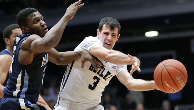Butler guard Alex Barlow is pressured by Villanova guard Dylan Ennis in the first half of the game at Hinkle Fieldhouse on Saturday, Feb. 14, 2015. The Bulldogs lost to the Wildcats 65-68.