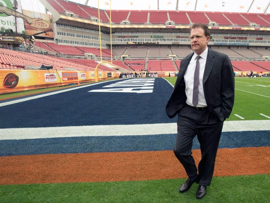 Auburn Head Coach Gus Malzahn walks from the field to the locker room before the Outback Bowl between Auburn and Wisconsin at Raymond James Stadium in Tampa, Fla., on Thursday, Jan. 1, 2015.