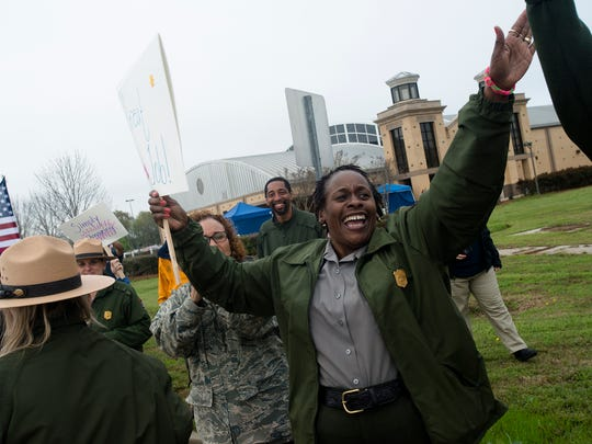 Park Ranger Lorraine Thomas cheers as marchers finish their daily march to commemorative march of the 1965 Selma to Montgomery March as part of the National Parks Service 50th Anniversary Walking Classroom outside of Selma, Ala., on Saturday, March 21, 2015. Marchers walk 12.9 miles on Sunday stopping ending at Lowndes Interpretive Center.