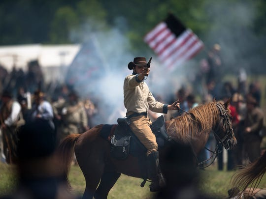 Re-enactors perform a re-enactment of the Battle of Selma on Sunday, April 26, 2015, in Selma, Ala. This years re-enactment marked Battle of Selma's 150th anniversary. The Battle of Selma occurred during the the Civil War in 1865.