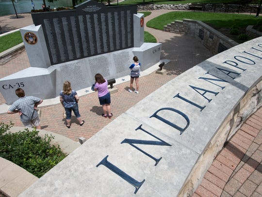 Dean Elliott (left), his wife Elise, Ft. Wayne, her sister Donna Parish, and Donna's daughter Mollie Parish, 16, Westfield, take a look at the USS Indianapolis memorial along the downtown canal in 2014.