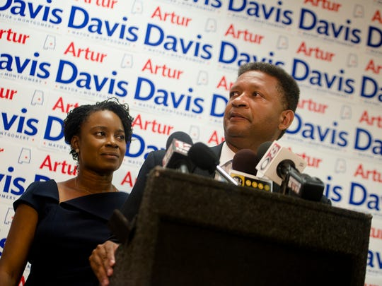 Artur Davis, right, and Tara Davis, his wife, greet supports during an election party at Artur Davis' headquarters on Tuesday, Aug. 25, 2015, in Montgomery, Ala.