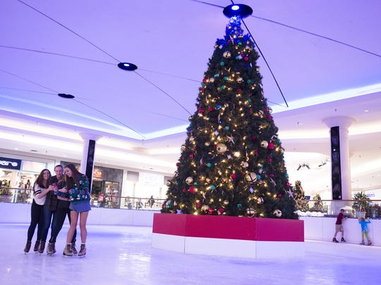 People ice skate in the ice rink inside the Eastdale Mall in Montgomery, Ala., Tuesday, Nov. 25, 2014.