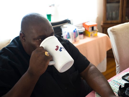 Rev. William Enoch McCoy drinks protein shake as part
