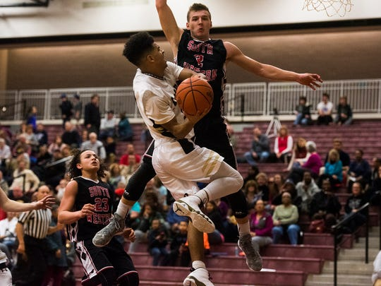 Delone's Tavian Dorsey goes in for a layup as South Western's Brock Geiman attempts a block Tuesday night Dec. 29, 2015 during the consolation varsity game in the Gettysburg Holiday Tournament.