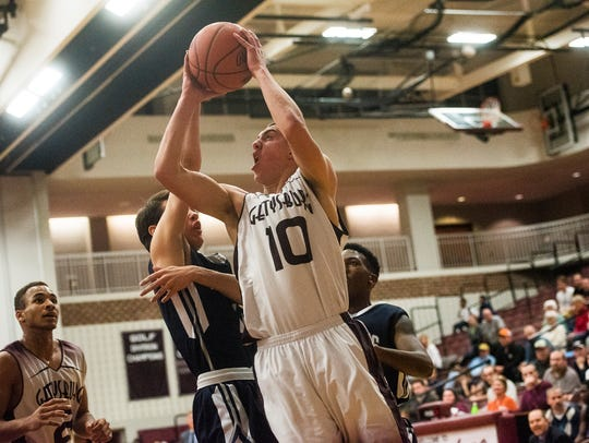 Gettysburg's Max Lampe drives for a shot against Chambersburg