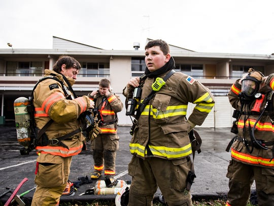 Firefighters prepare to enter the vacant motel building on Steinwehr Avenue in Gettysburg on Saturday Jan. 16, 2016 during a training exercise hosted by the Gettysburg Fire Department with Adams County fire departments.