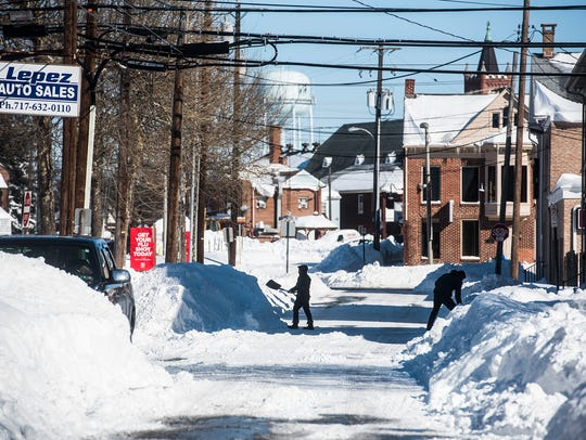 Hanover residents dig out Sunday Jan. 24, 2016.