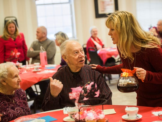 Julie Deal with Rep. Kate Klunk's office offers coffee and tea to couple Bill and Ruth Kopp of Hanover on Thursday during the Senior Sweetheart Tea event at the Hanover YWCA.