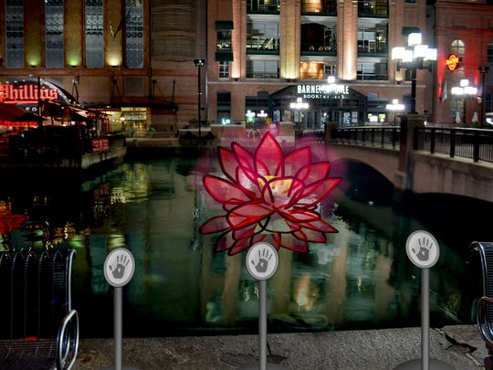 """Laser Lotus"" will bloom on the water at the Inner Harbor during the Light City festival in Baltimore. The free event starts March 28 and runs for seven days."