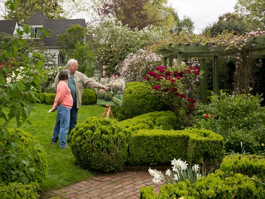 Phelps and Julie Shepard look at the gardens at the Gaiety Hollow house in April 2016. The gardens were designed by famous Northwest landscape architects Elizabeth Lord and Edith Schryver in the 1930s.