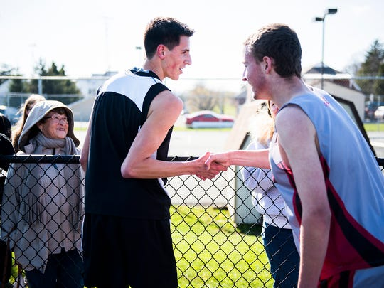 Biglerville's Daniel Wood congratulates Bermudian Springs' Chad Long after competing in the 1600 meter run on April 12, 2016 at Biglerville High School. Woods came in first place in the run.