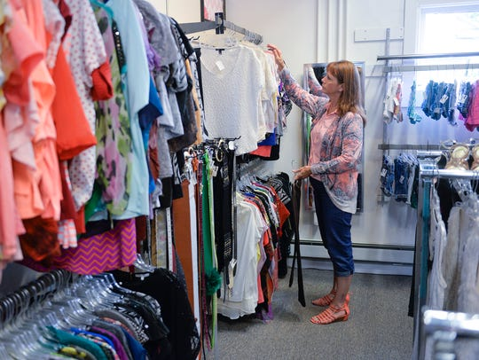 Brenda Halverson, Albany, looks through the racks of